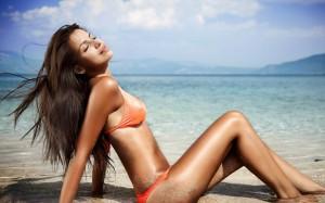 Suntanning-on-Beach-1050x1680